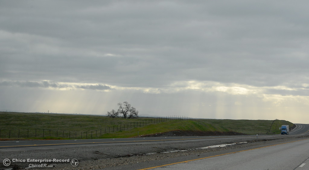 . Rays of sunshine poke through the clouds as a truck drives north on hwy. 99 south of Chico, Calif. Thurs. Jan. 25, 2018.  Bill Husa -- Enterprise-Record)