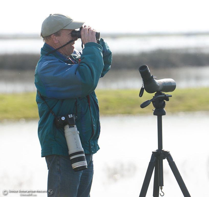 . Allen Bertke of Grass Valley looking at birds through his binoculars, spotting scope and camera ready, during the Snow Goose Festival Saturday, January 27, 2018, in Chico, California. (Carin Dorghalli -- Enterprise-Record)