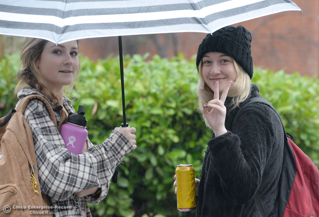 . Jordan Karuza left and Hailey Silverstein share an umbrella and a smile as students roam around campus as the spring semester begins with a bit of rain on the CSUC campus Monday Jan. 22, 2018. (Bill Husa -- Enterprise-Record)