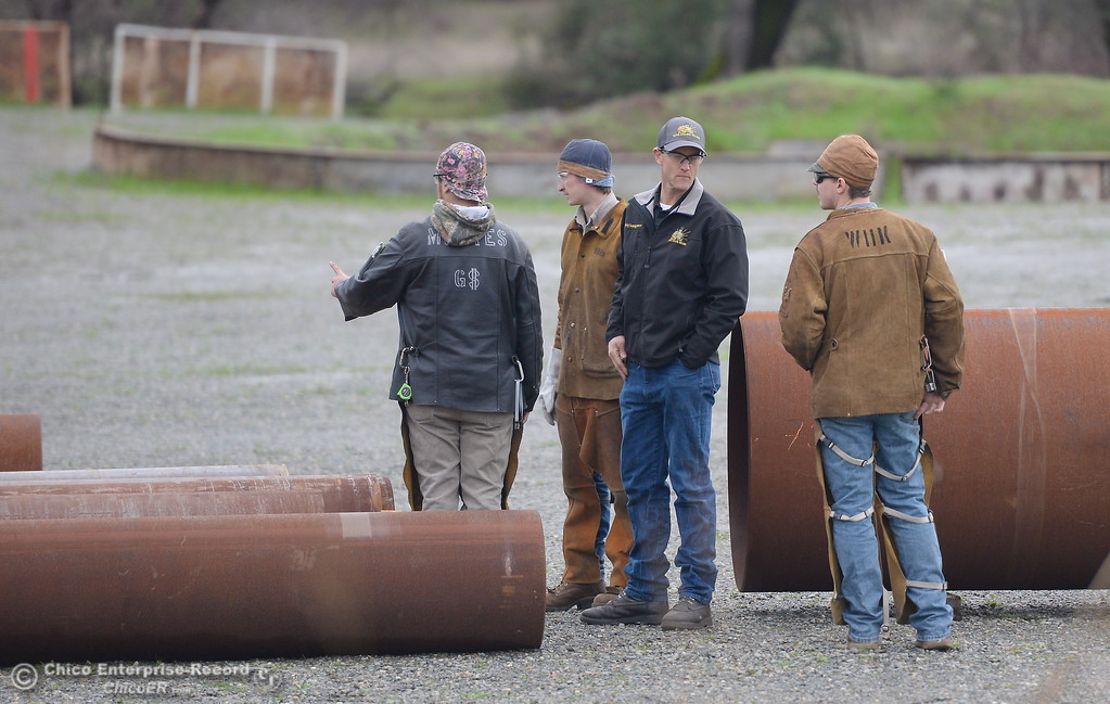 . Welders get ready to cut into 70 tons of steel pipe donated to the Butte College welding program by PG&E into smaller pieces to make them more manageable at the Butte College Welding facility on the Main Campus at Butte College Thurs. Jan. 25, 2018.  Bill Husa -- Enterprise-Record)
