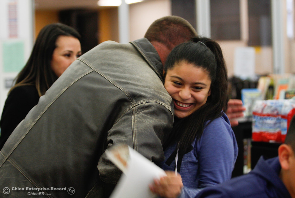 . Bidwell Junior High School principal, Dave McKay, congratulates a student for passing the California English Language Development Test Thursday, January 25, 2018 at Bidwell Junior High School in Chico, California. (Carin Dorghalli -- Enterprise-Record)