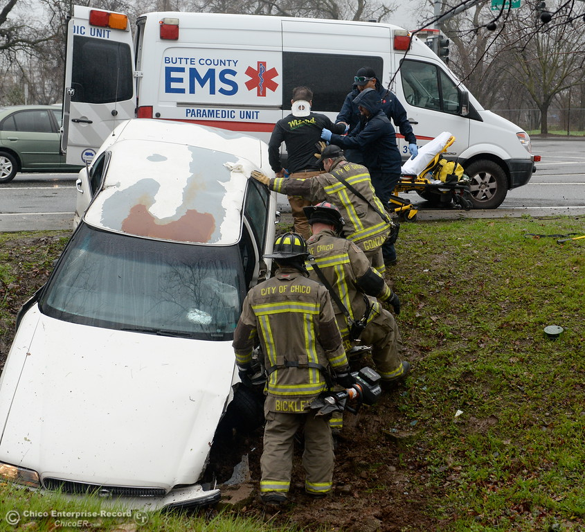. Firefighters work to extricate the driver of a white sedan following a single vehicle accident into a pole near Skyway and Park Ave. intersection Monday Jan. 22, 2018. (Bill Husa -- Enterprise-Record)