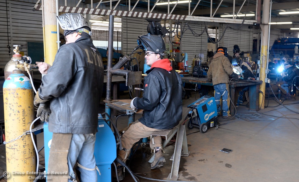 . Welders Cliff Kroeger and Roland Lynn practice ther gas metal arc welding GMAW at the Butte College welding program facility on the Main Campus at Butte College Thurs. Jan. 25, 2018.  PG&E donated 70 tons of metal pipe to the program for the welding students to use Thursday. (Bill Husa -- Enterprise-Record)