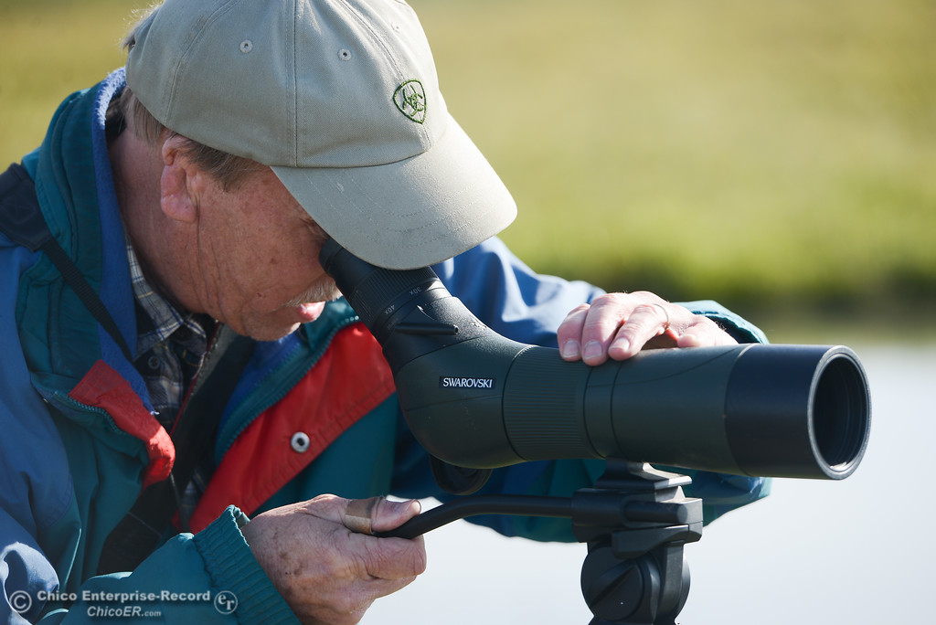 . Allen Bertke of Grass Valley peering through his spotting scope during the Snow Goose Festival Saturday, January 27, 2018, in Chico, California. (Carin Dorghalli -- Enterprise-Record)