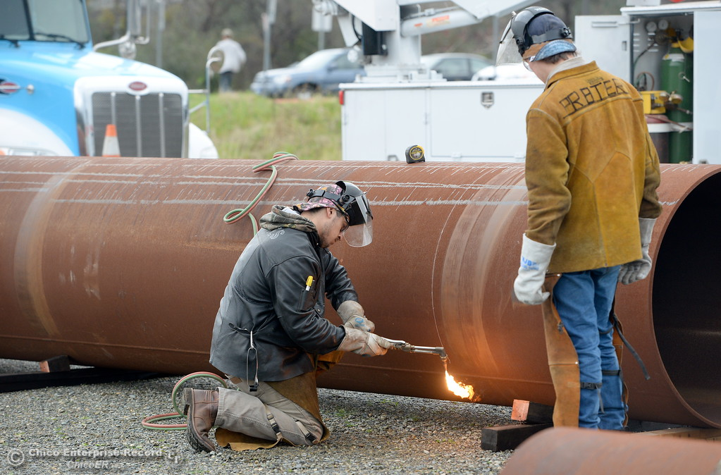 . 70 tons of metal pipe is delivered to the Butte College Welding department Thursday. At left, Giovanni Montes fires up a cutting torch with Levi Prater at right as they get ready to cut pipes into smaller pieces to make them more manageable at the Butte College Welding facility on the Main Campus at Butte College Thurs. Jan. 25, 2018.  Bill Husa -- Enterprise-Record)