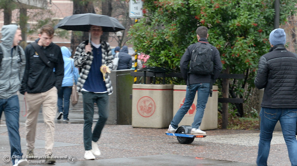 . A man is seen on a one wheeled electric skateboard as students roam between classes on the CSUC campus as the spring semester begins Monday Jan. 22, 2018. (Bill Husa -- Enterprise-Record)