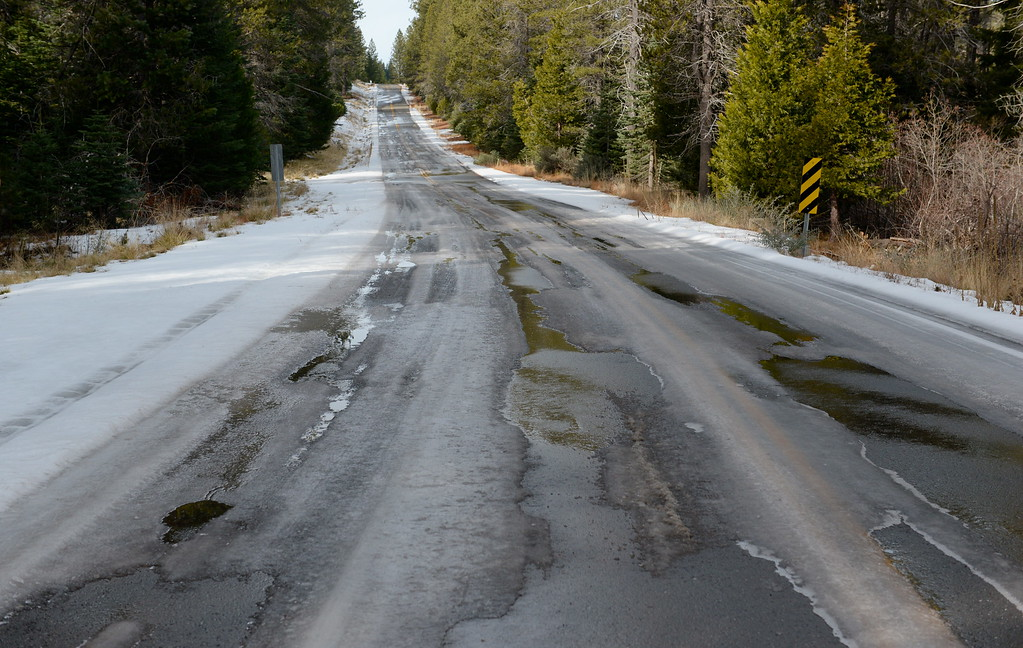 . An icy section of roadway is seen above Inskip Tuesday. The paved Skyway from Inskip to Butte Meadows is accessible by an average car without 4 wheel drive today due to a lack of snow Tuesday Jan. 2, 2018. (Bill Husa -- Enterprise-Record)