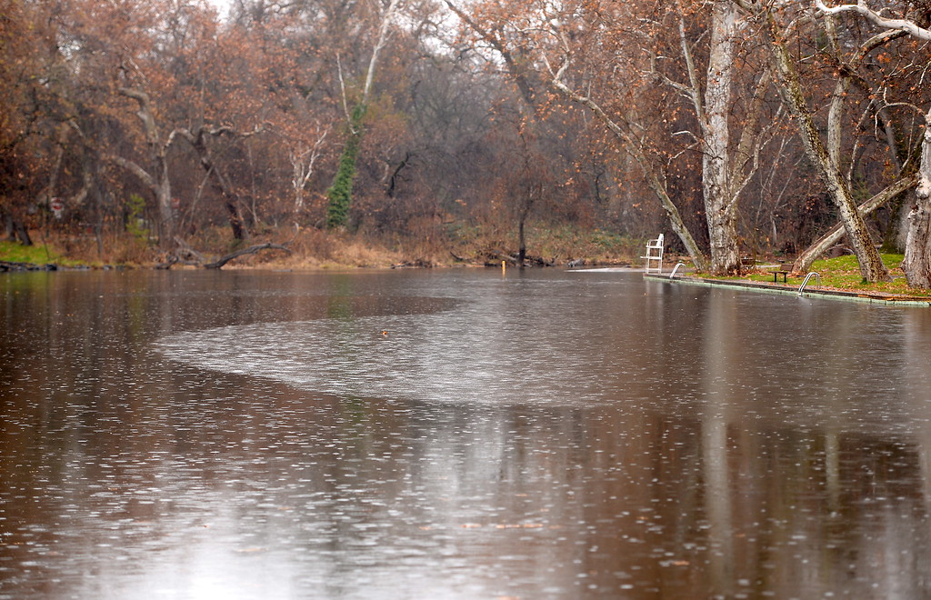 . Raindrops create a pattern on the water at Sycamore Pool in Bidwell Park Friday Jan. 5, 2018.  (Bill Husa -- Enterprise-Record)