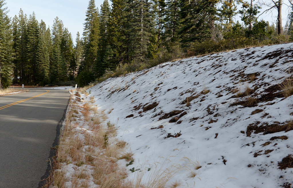 . A tiny bit of snow is seen along the side of the road above Inskip Tuesday. The paved Skyway from Inskip to Butte Meadows is accessible by an average car without 4 wheel drive today due to a lack of snow Tuesday Jan. 2, 2018. (Bill Husa -- Enterprise-Record)