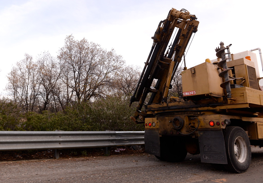 . A large mowing machine trims Oleander bushes in the center divide along southbound Hwy. 99 in Chico, Calif. Wed. Dec. 3, 2018. (Bill Husa -- Enterprise-Record)