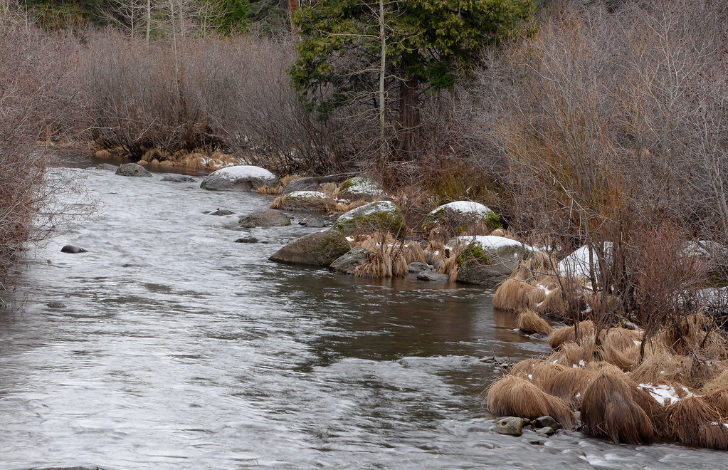 . A few slightly snowcapped rocks are seen along Butte Creek near Butte Meadows Tuesday. The paved Skyway from Inskip to Butte Meadows is accessible by an average car without 4 wheel drive today due to a lack of snow Tuesday Jan. 2, 2018. (Bill Husa -- Enterprise-Record)