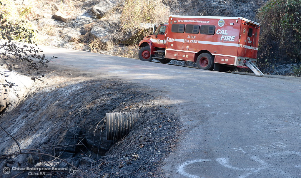 . A CAL FIRE truck is seen along Honey Run Road where the fire appears to have crossed the road down into the canyon during the Honey Run Fire that ran up from Butte Creek Canyon to lower Paradise, Calif. Tuesday. (Bill Husa -- Enterprise-Record)