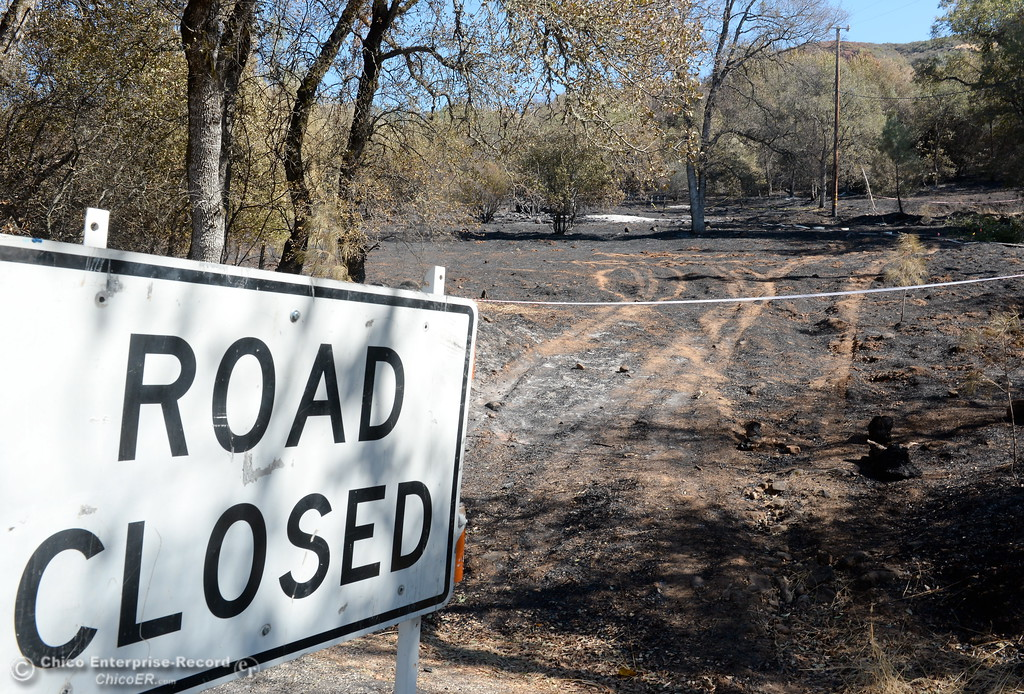 . Honey Run Road remains closed near the Honey Run Fire after it ran up from Butte Creek Canyon to lower Paradise, Calif. Tuesday. (Bill Husa -- Enterprise-Record)