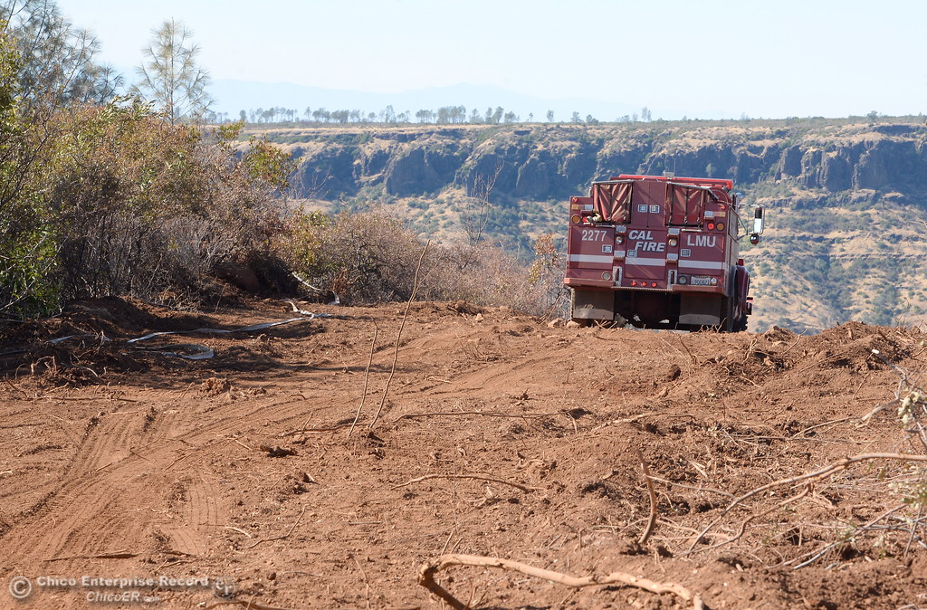 . Charred brush and debris are seen Thursday within the fire lines of the Honey Run Fire that ran up from Butte Creek Canyon to lower Paradise, Calif. Tuesday. (Bill Husa -- Enterprise-Record)