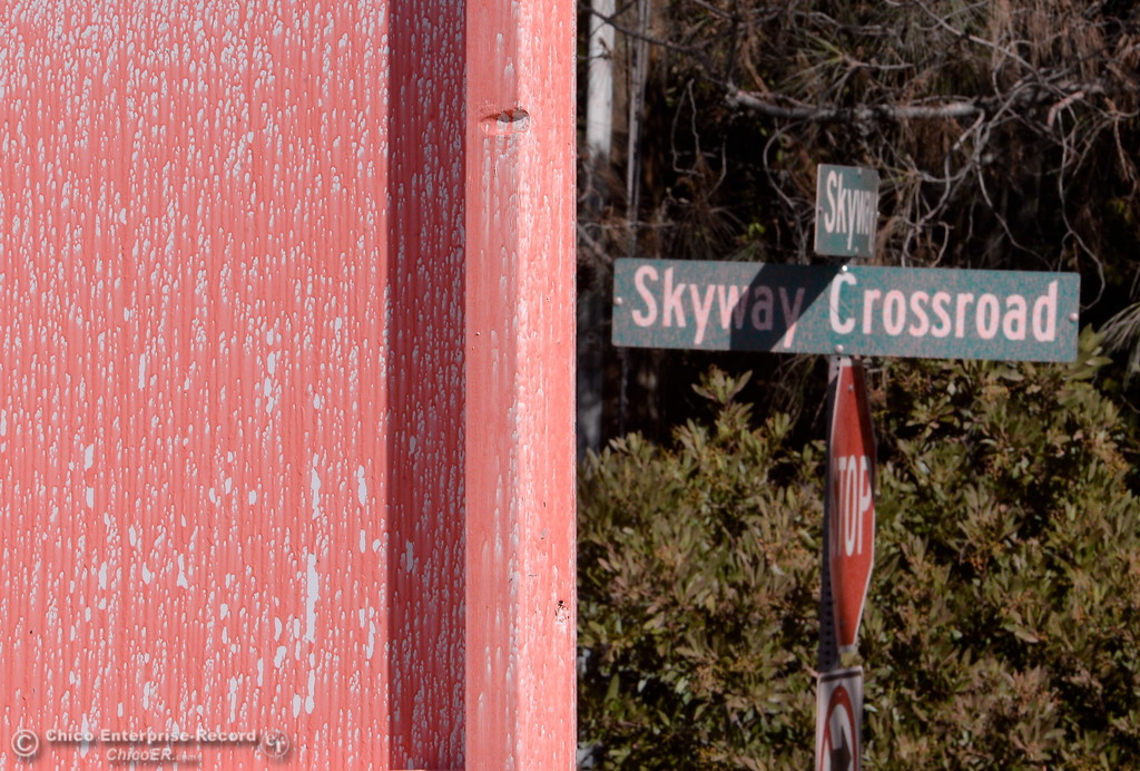 . A sign near the Skyway Crossroad is spattered with slurry after the Honey Run Fire ran up from Butte Creek Canyon to lower Paradise, Calif. Tuesday. (Bill Husa -- Enterprise-Record)