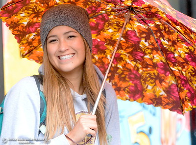 Emily Foley of Chico smiles as she walks along W. 2nd Street enjoying the rain in downtown Chico, Calif. Tues. Oct. 25, 2016. (Bill Husa -- Enterprise-Record)