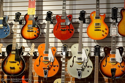 Guitars hang from the walls and ceiling at Herreid Music in Chico, Calif. Tues. Oct. 25, 2016. (Bill Husa -- Enterprise-Record)