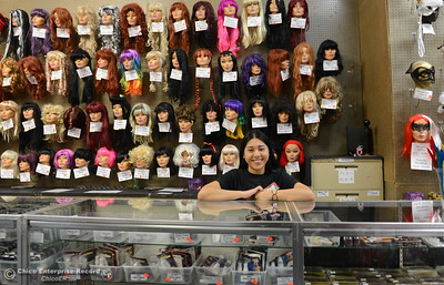Sales associate Estela Flores smiles between helping customers with wigs and makeup Saturday, Oct. 29, 2016, at Dracula's Closet in Chico, California. (Dan Reidel -- Enterprise-Record)