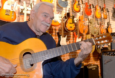 Legendary guitar player Charlie Robinson teaches guitar at Herreid Music in Chico, Calif. Tues. Oct. 25, 2016. (Bill Husa -- Enterprise-Record)