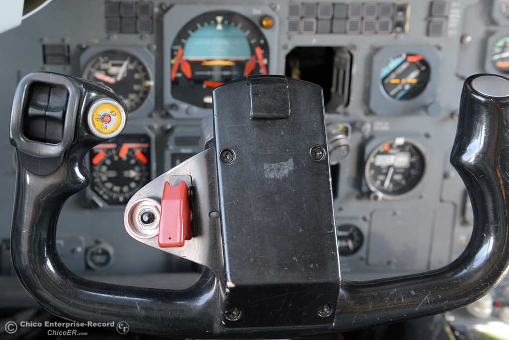 . The red button seen on the yoke of the Air Spray T-170 is used to drop fire retardent seen here while parked near the Chico Air Museum at the Chico Airport in Chico, Calif. Thurs. Oct. 5, 2017. (Bill Husa -- Enterprise-Record)