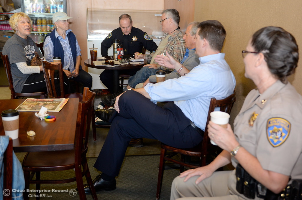 . Chico Police Chief Mike O\'Brien and CHP Commander April Baxter enjoy coffee with Lauree Asarian, Marcia Tarabini, Bill Mash, Rob Berry and Eric Root during National Coffee with a Cop day at Cal Java in Chico, Calif. Wed. Oct. 4, 2017. (Bill Husa -- Enterprise-Record)