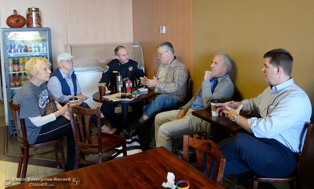 . Left to right, Marcia Tarabini, Lauree Asarian, Chico Police Chief Mike O\'Brien, Bill Mash, Rob Berry and Mayor Sean Morgan enjoy a cup and a chat during National Coffee with a Cop day at Cal Java in Chico, Calif. Wed. Oct. 4, 2017. (Bill Husa -- Enterprise-Record)