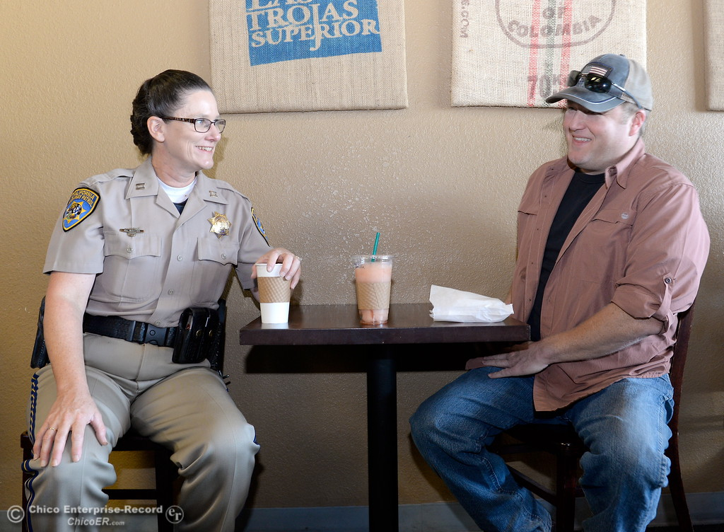 . CHP Commander April Baxter enjoys coffee with Eric Root during National Coffee with a Cop day at Cal Java in Chico, Calif. Wed. Oct. 4, 2017. (Bill Husa -- Enterprise-Record)