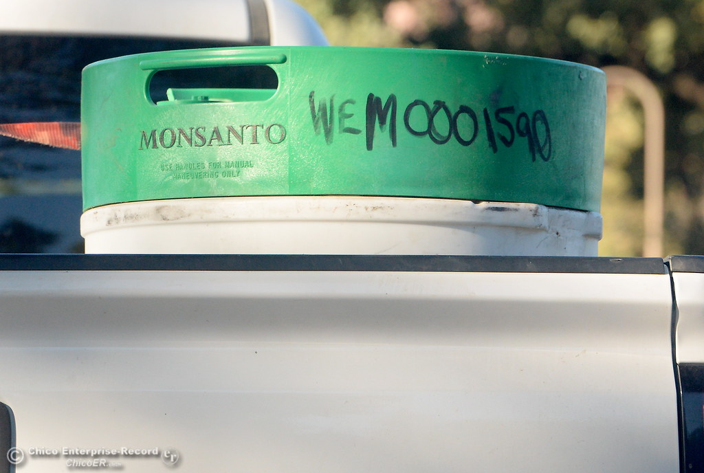 . Monsanto Barrels are seen in the back of a pickup in Chico, Calif. Tues. Sept. 26, 2017. (Bill Husa -- Enterprise-Record)