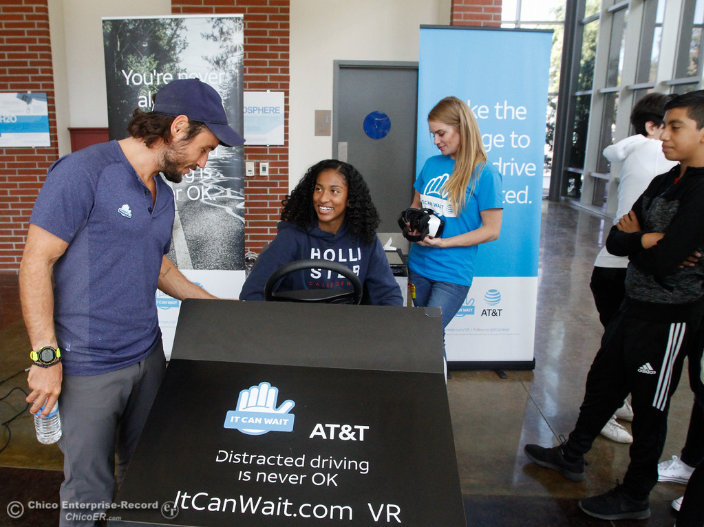 . AT&T It Can Wait spokesperson Chris Johnson, left, helps students in Vallarie Jensen\'s health education class experience distracted driving first hand in a virtual reality simulator Tuesday October 3, 2017 in Chico, California. (Emily Bertolino -- Enterprise-Record)