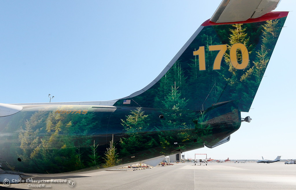 . The colorful tail section of an Air Spray T-170 is wrapped with an image of trees in the forest as it sits parked near the Chico Air Museum at the Chico Airport in Chico, Calif. Thurs. Oct. 5, 2017. (Bill Husa -- Enterprise-Record)