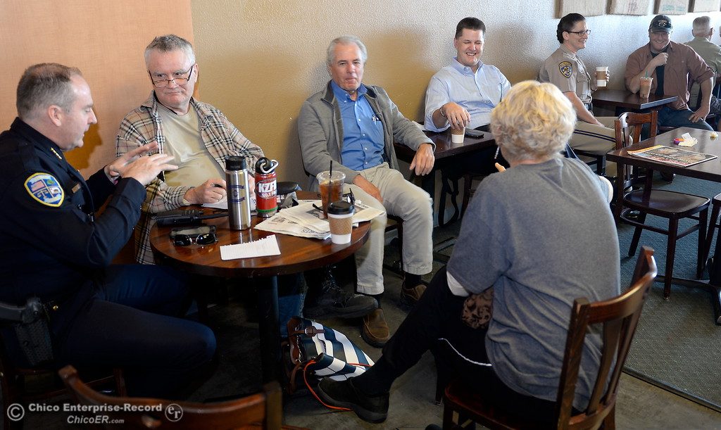 . Left to right, Chico Police Chief Mike O\'Brien, Bill Mash, Rob Berry, Mayor Sean Morgan, CHP Commander April Baxter, Eric Root and Marcia Tarabini (back facing camera, enjoy a cup and a chat during National Coffee with a Cop day at Cal Java in Chico, Calif. Wed. Oct. 4, 2017. (Bill Husa -- Enterprise-Record)