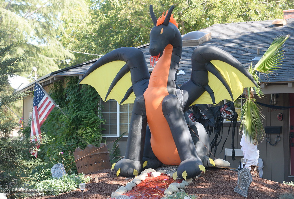 . A giant dragon with glowing eyes flaps its wings as Halloween decorations have begun to pop up along Floral Ave. near Calla Lane in Chico, Calif. Thurs. Oct. 5, 2017. (Bill Husa -- Enterprise-Record)