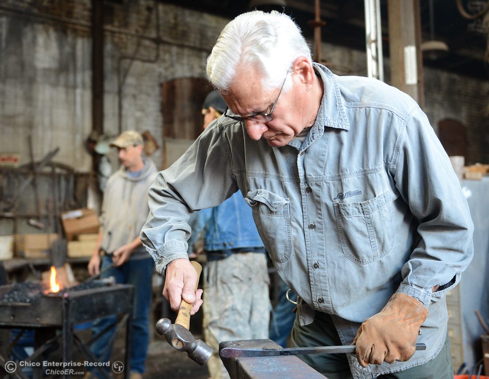 . Chico Blacksmith association member Art Figueroa forges metal November 11, 2017 at Richer\'s Earthen Iron in Chico, California. (Emily Bertolino -- Mercury Register)