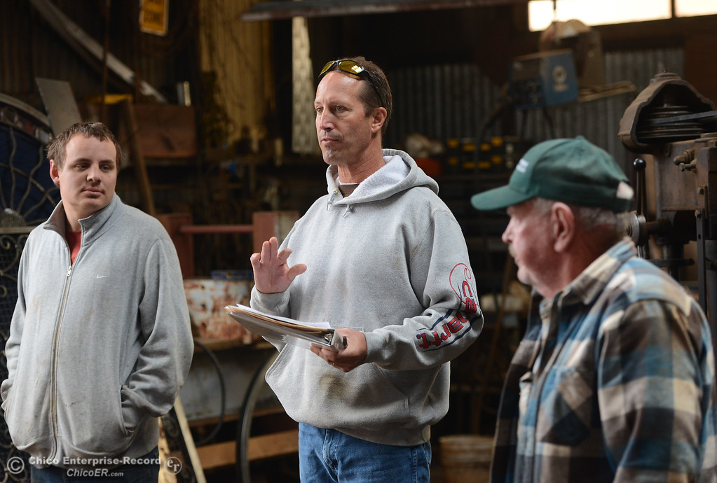 . Chico Blacksmith association founder Doug Maxfield, center, talks about raising money so the group can move out to Patrick Ranch November 11, 2017 at Richer\'s Earthen Iron in Chico, California. (Emily Bertolino -- Mercury Register)