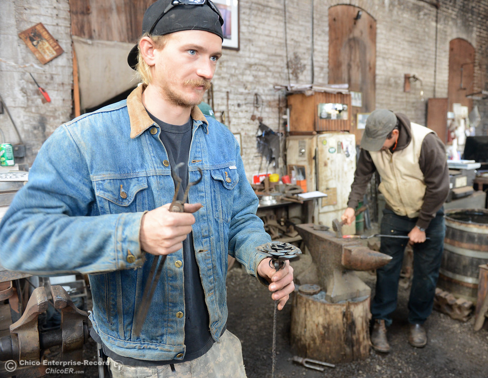 . Chico Blacksmithing association member Devin Peterson talks about the metal roses he forges November 11, 2017 at Richer\'s Earthen Iron in Chico, California. (Emily Bertolino -- Mercury Register)