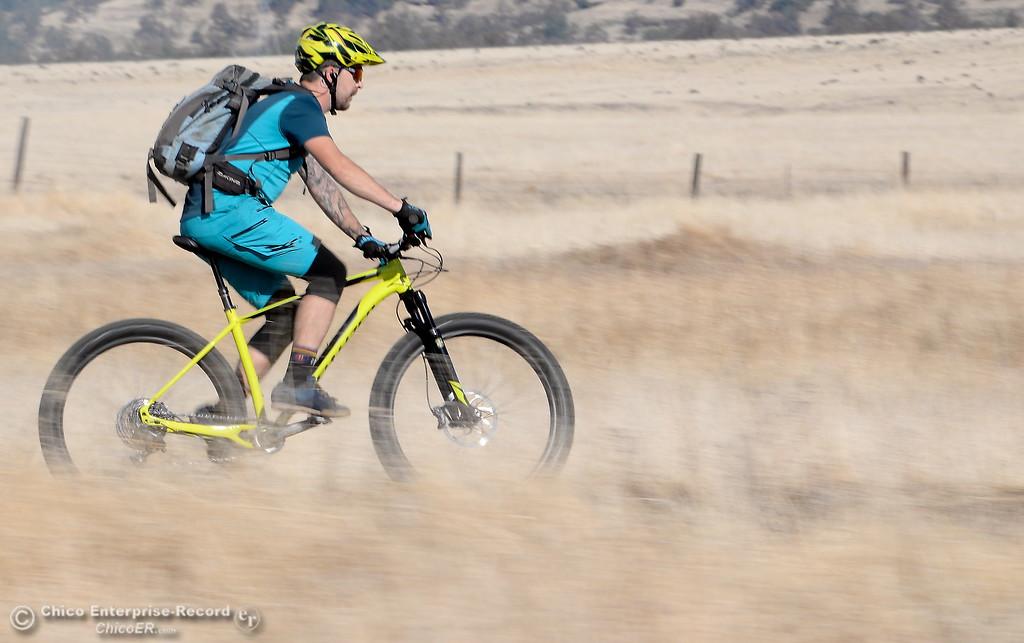 . A mountain bike rider enjoys a ride along a trail through the dry grass in Upper Bidwell Park in Chico, Calif. Tues. Nov. 7, 2017.  (Bill Husa -- Enterprise-Record)
