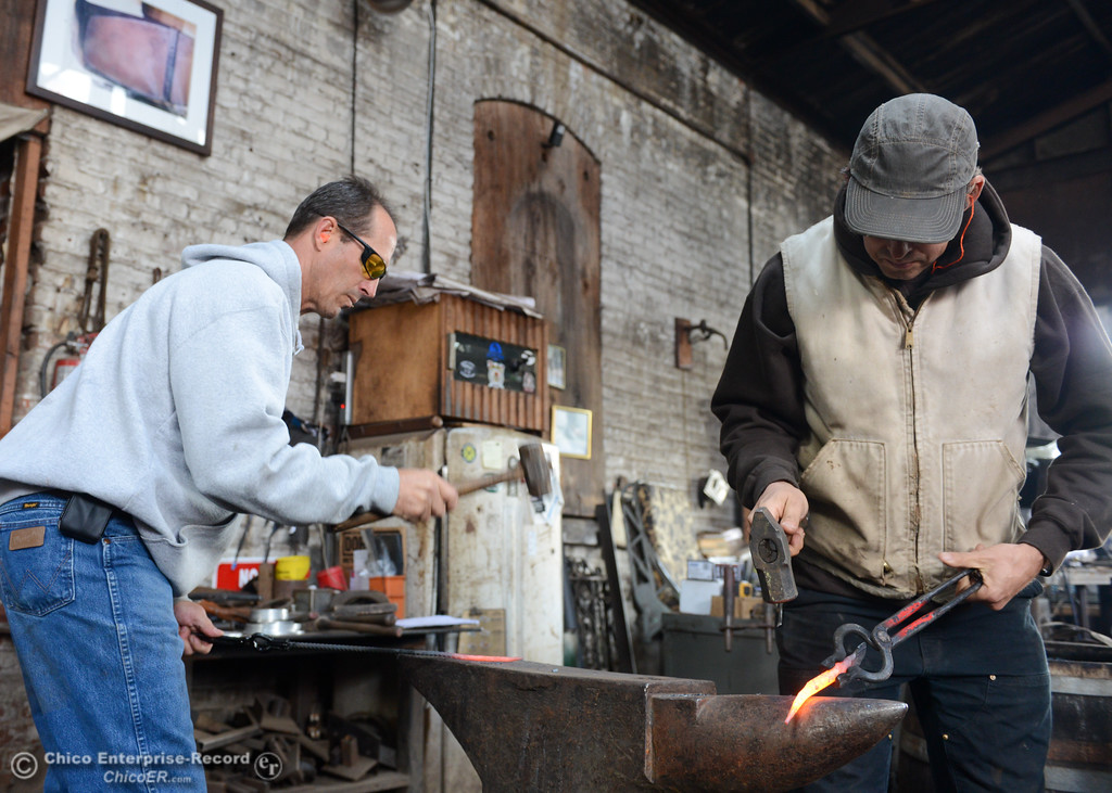 . Chico Blacksmith association founder Doug Maxfield, left, and Zeke Lunder work on metal projects November 11, 2017 at Richer\'s Earthen Iron in Chico, California. (Emily Bertolino -- Mercury Register)