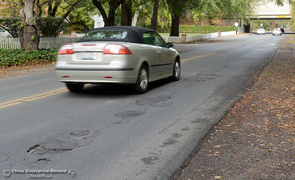 . The City of Chico plans to tear out sections of asphalt and replace it along Vallombrosa Ave. after receiving several complaints. Here, vehicles dodge potholes along a stretch between Hwy. 99 and One Mile Thurs. Nov. 9, 2017 in Chico, Calif..  (Bill Husa -- Enterprise-Record)