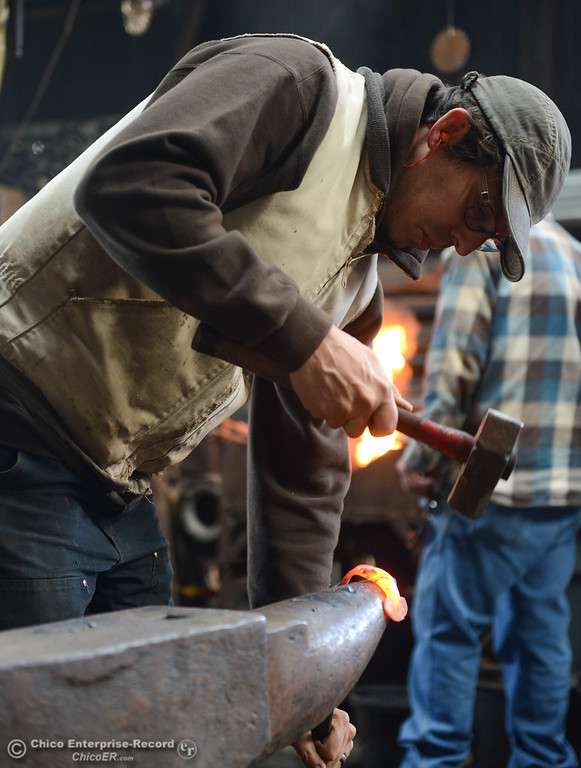 . Zeke Lunder makes a coat hook during a Chico Blacksmith association meeting November 11, 2017 at Richer\'s Earthen Iron in Chico, California. (Emily Bertolino -- Mercury Register)