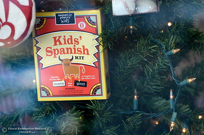 A Kids' Spanish kit is seen on a Christmas Tree in a storefront as Chico was named one of the best towns for holiday shopping. Storefronts like this are already underway for the holiday shopping season Monday Nov. 14, 2016. (Bill Husa -- Enterprise-Record)