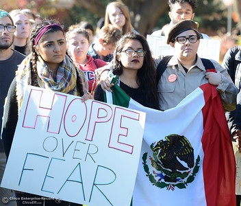 Holding signs and flags, students and faculty listen to speakers talk about their fears and experiences during a solidarity rally on the Chico State University Glenn Hall lawn Wednesday, Nov. 16, 2016, in Chico, California. (Dan Reidel -- Enterprise-Record)