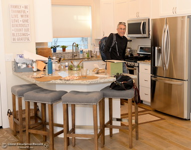 Developer Kevin Kramer smiles inside of the kitchen of a single family home that he and his wife Robin occupy at the West Side Place neighborhood on Nord Ave. in Chico, Calif. Wed. Nov. 16, 2016. The area began development many years ago under a different developer but Kramer is currently working on five new fourplexes and has more plans for the area. (Bill Husa -- Enterprise-Record)