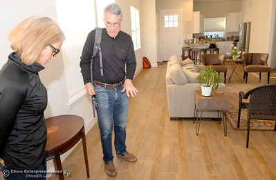 Developer Kevin Kramer and his wife Robin talk about the flooring style used in a single family home at the West Side Place neighborhood on Nord Ave. in Chico, Calif. Wed. Nov. 16, 2016. The area began development many years ago under a different developer but Kramer is currently working on five new fourplexes and has more plans for the area. (Bill Husa -- Enterprise-Record)