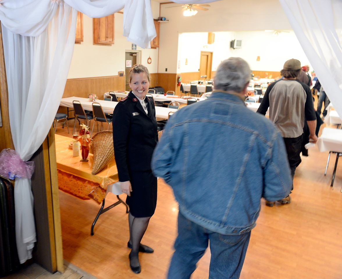 Lieutenant Arwyn Rodriguera welcomes guests during the Salvation Army's annual thanksgiving dinner held at the Eagles Hall in Chico, Calif. Thurs. Nov. 23, 2017. (Bill Husa -- Enterprise-Record)