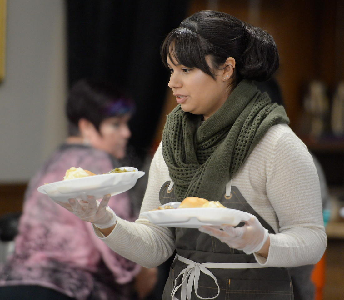 Katalina Santamaria helps serve guests during the Salvation Army's annual thanksgiving dinner held at the Eagles Hall in Chico, Calif. Thurs. Nov. 23, 2017. (Bill Husa -- Enterprise-Record)