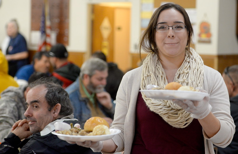 Destiny Winquest helps serve guests during the Salvation Army's annual thanksgiving dinner held at the Eagles Hall in Chico, Calif. Thurs. Nov. 23, 2017. (Bill Husa -- Enterprise-Record)
