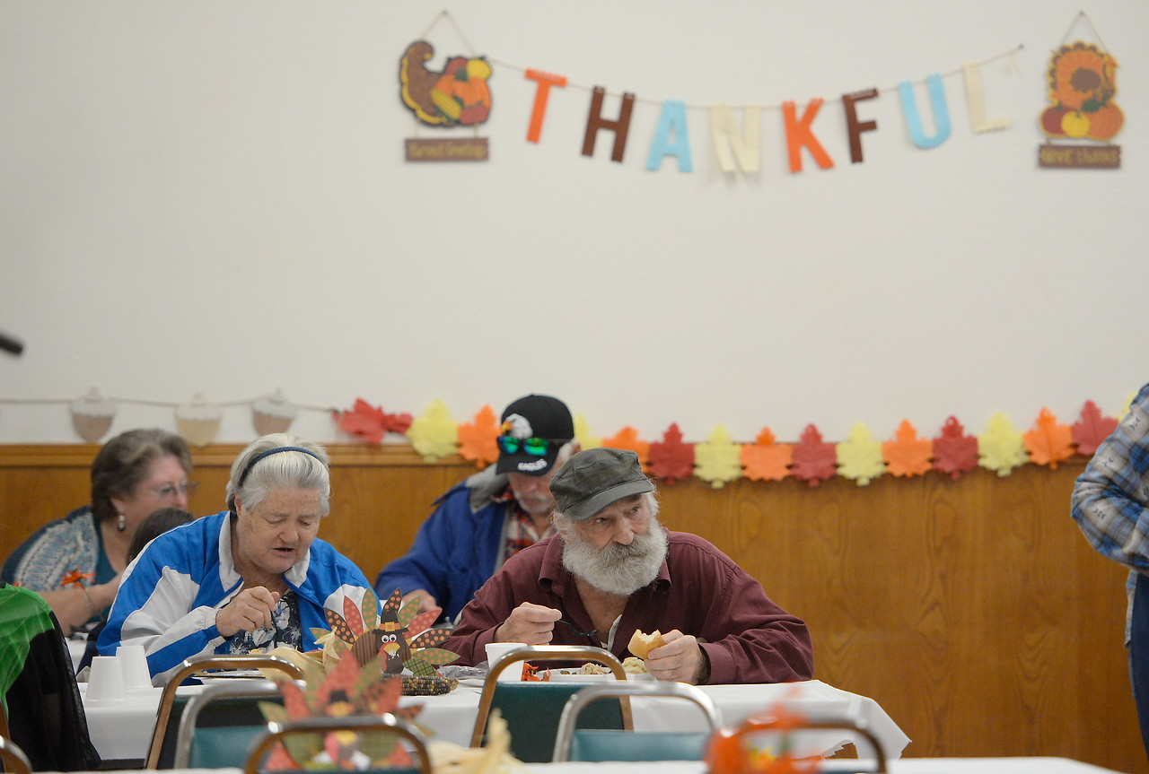 Guests enjoy their meal during the Salvation Army's annual thanksgiving dinner held at the Eagles Hall in Chico, Calif. Thurs. Nov. 23, 2017. (Bill Husa -- Enterprise-Record)