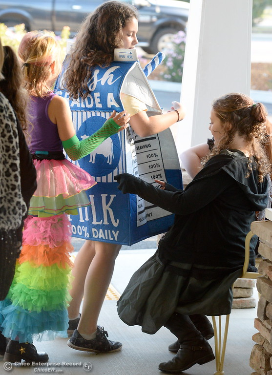 . Students in Beth Geise\'s 5th grade Class at Hooker Oak including Layla Humble, dressed as a milk carton play games, make cookies and visit with residents during a Halloween celebration at Amber Grove Place in Chico, Calif. Tues. Oct. 31, 2017. (Bill Husa -- Enterprise-Record)