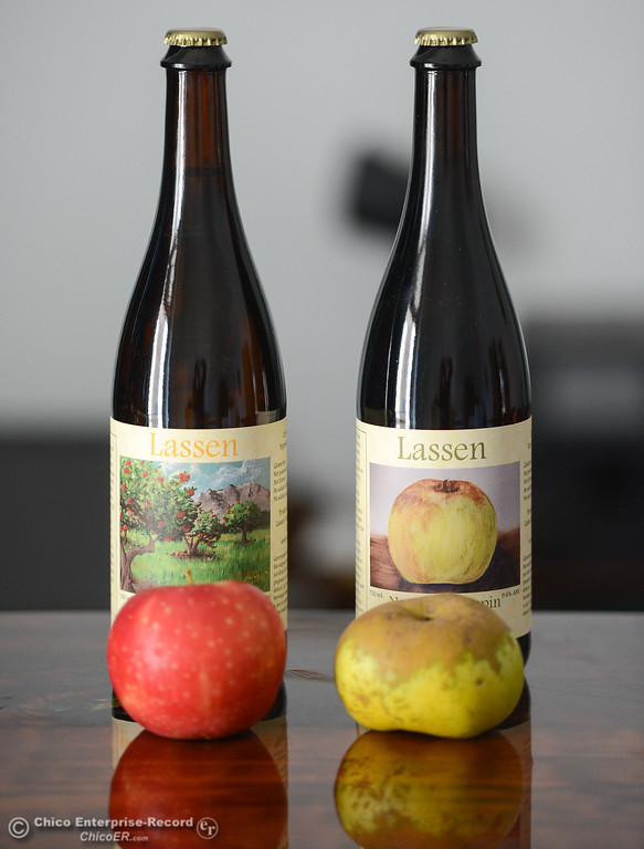 . A Winesap and Newtown Pippin apple sit in front of the ciders they help produce Wednesday November 1, 2017 in Chico, California. (Emily Bertolino -- Enterprise-Record)