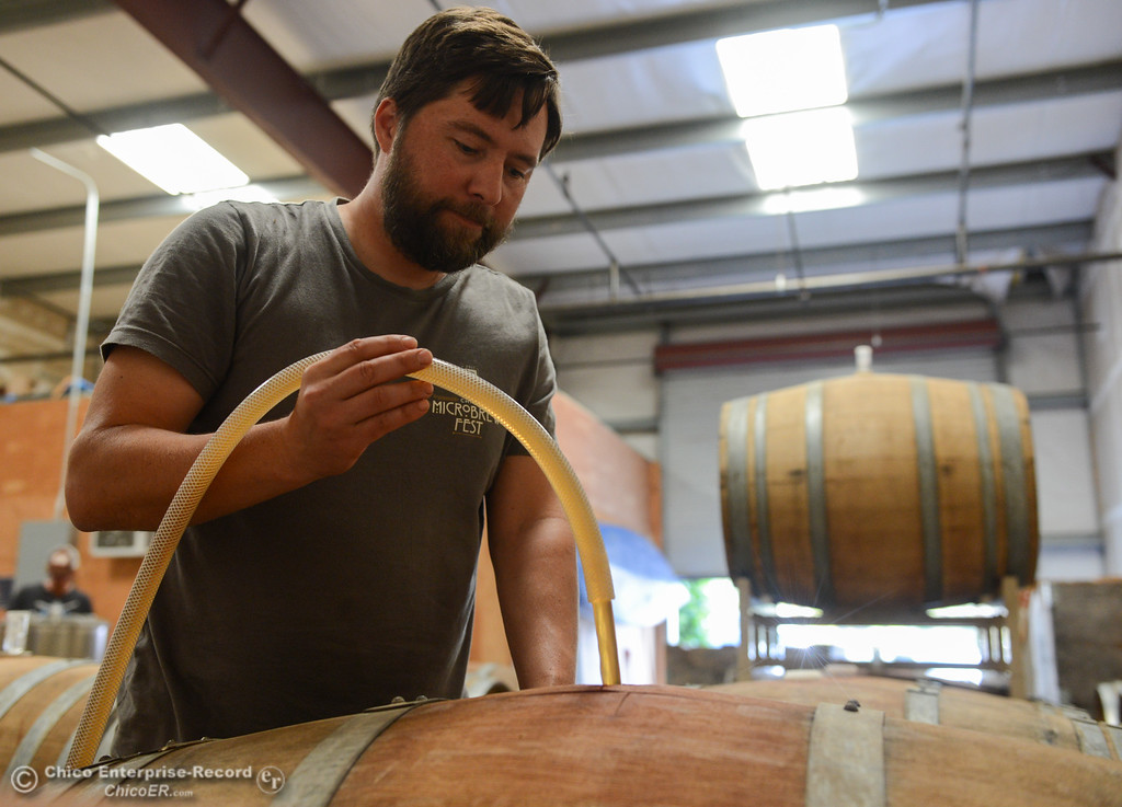 . Ben Nielsen of Lassen Cidery watches as freshly pressed apple juice fills a barrel for his new batch of apple cider Wednesday November 1, 2017 in Chico, California. (Emily Bertolino -- Enterprise-Record)